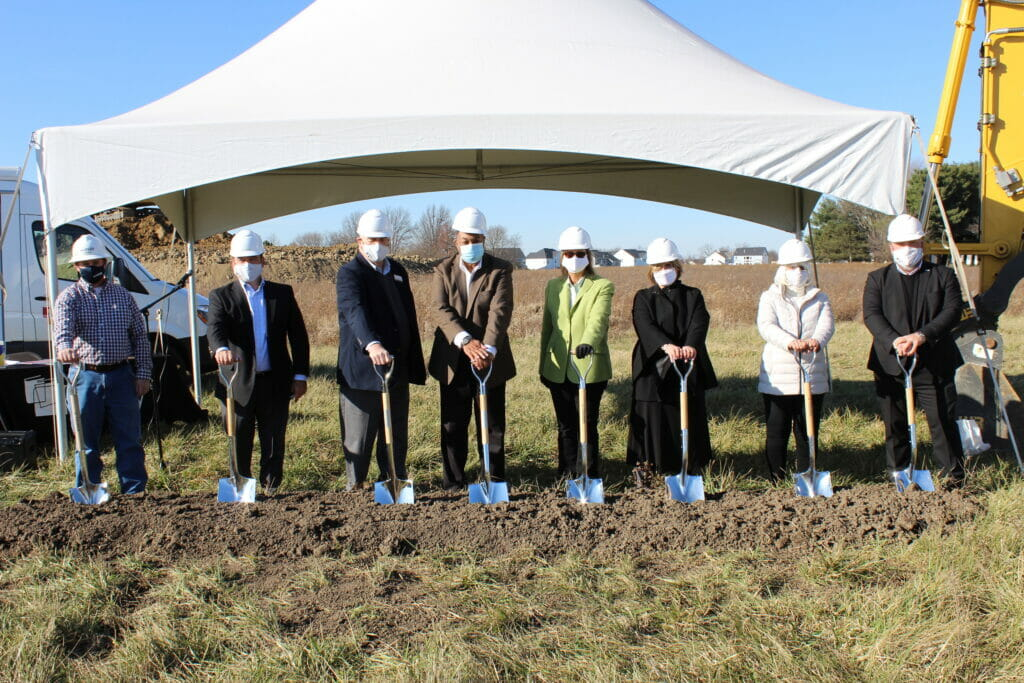 Representatives from Powell, Delaware Library, and the architecture and construction firms prepare to break ground
